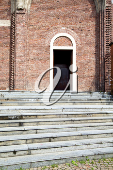 italy  lombardy     in  the cardano al campo old   church  closed brick tower     wall