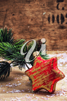 old-fashioned Christmas toy on the background of fir-tree branches