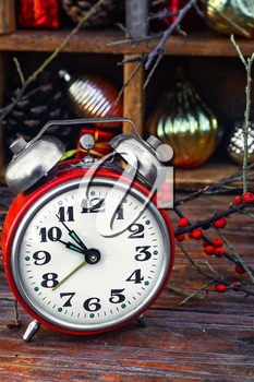 Clock alarm clock with bells on the background of Christmas decorations