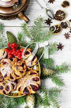 Homemade cookies on plate decorated with fir branches