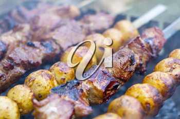 Barbecue shish kebab cooking. Grill potatoes dinner cook. Tasty food BBQ background. Roasted fresh beef meat