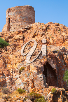 Ancient Genoese tower on Capo Rosso, Corsica island, France. Vertical photo