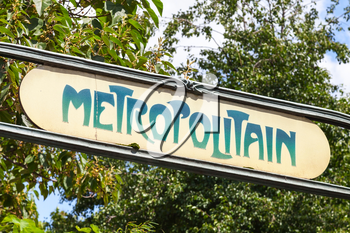Art-Deco styled Street sign at the entrance to the Paris Metro