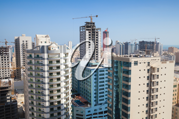 Modern office buildings and hotels are under construction in city Manama City, Bahrain