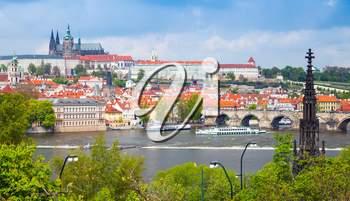 Old Prague cityscape with St. Vitus Cathedral and Charles Bridge. Czech Republic