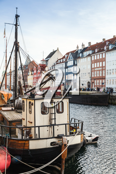 Ships moored in Nyhavn, 17th-century waterfront, canal and popular touristic district in Copenhagen, Denmark