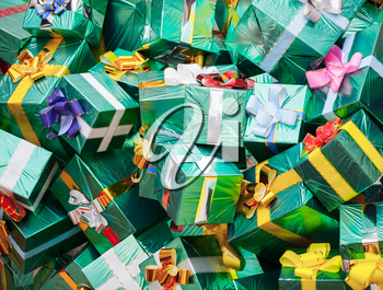 Huge pile of green gift boxes with colorful bows