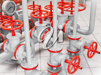 Group of red industrial valves on gray pipelines