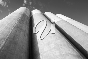 Abstract industrial architecture fragment, large tanks made of concrete for storage of bulk materials