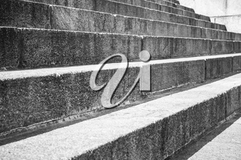 Abstract architecture fragment. Old stairway made of granite stone blocks, closeup photo with selective focus