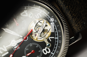 Mechanical luxury men wrist watch with automatic winding, closeup dial fragment