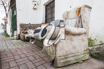 Old abandoned furniture on narrow street of Izmir, Turkey