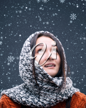 snowflakes fall on the head of a young girl