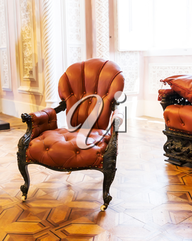 Luxuroius vintage leather-covered arm-chair in the room