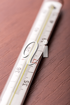 Thermometer on a wooden table closeup