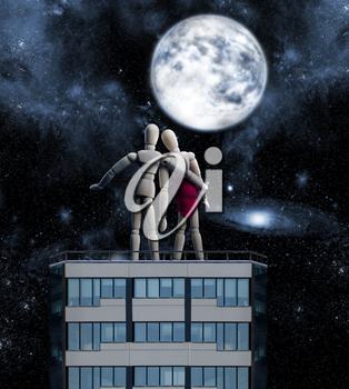 Couple of wooden figures on the top of the building hugging looking at the night sky