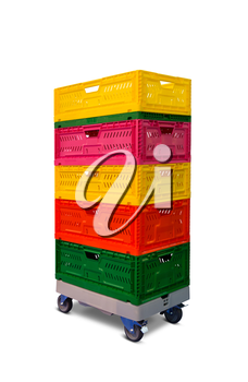 Pile of multicolored plastic boxes on the shelf with wheels
