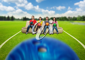 Bowling team sitting on the sofa on the lawn