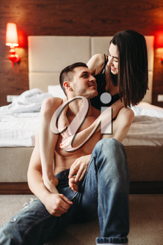 Sexy love couple hugging and have a fun in bedroom. Intimate games in bed, sex lovers intimacy