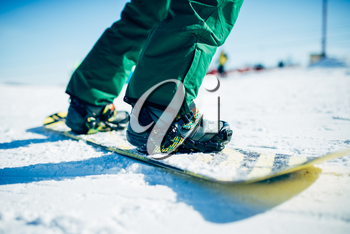Snowboarder riding a snow hill. Winter extreme sport, active lifestyle. Snowboarding in mountains