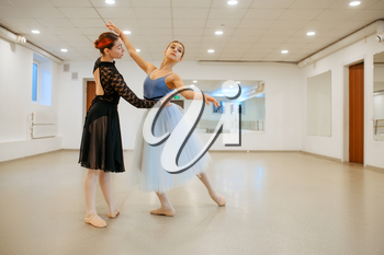 Choreographer works with young ballerina in class. Ballet school, female dancers on choreography lesson, girls practicing grace dance