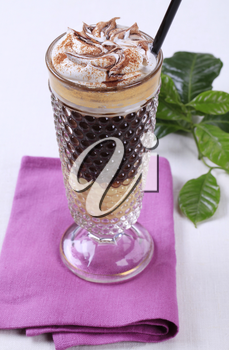 Liqueur coffee with whipped cream and chocolate sauce