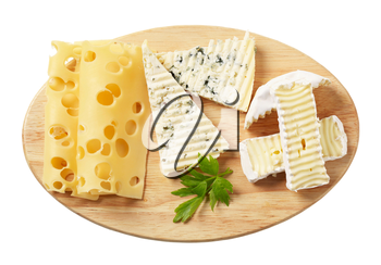 Variety of cheeses on a cutting board