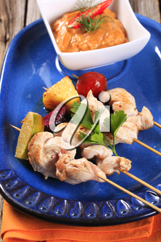 Chicken skewers and vegetable dipping sauce