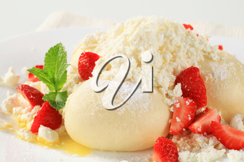 Strawberry dumpling with cottage cheese, sugar and butter