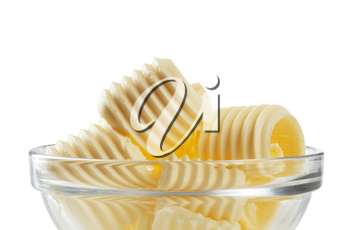 Curls of fresh butter in a glass bowl
