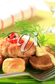 Meat patty with baked potatoes and mayonnaise