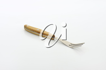 Three pronged fork with wooden handle