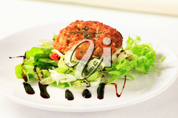 Vegetable burger with green salad
