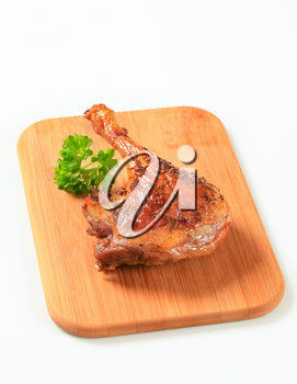 Roast duck leg topped with caraway seeds