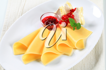 Two kinds of cheese and red currant sauce