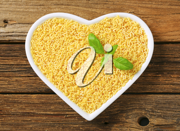 Plate of small letter-shaped pasta