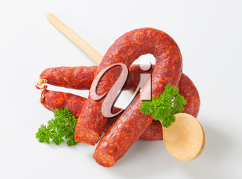 Spicy dry sausages and wooden  spoon