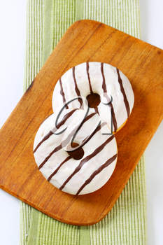 Ring donuts with vanilla and chocolate glaze