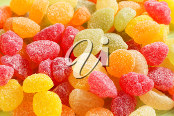 Fruit-shaped gummy candy coated in granulated sugar