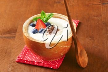 Smooth semolina porridge served with fresh fruit and grated chocolate