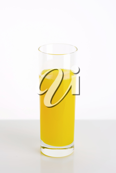 Yellow lemon juice drink served in tall glass
