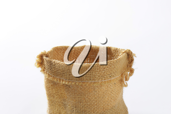 Empty Hessian sack on white background