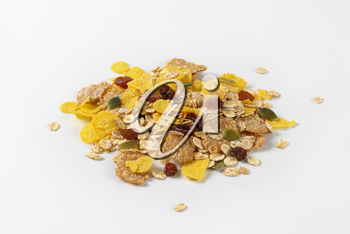 pile of mixed breakfast cereals with pieces of dried fruit