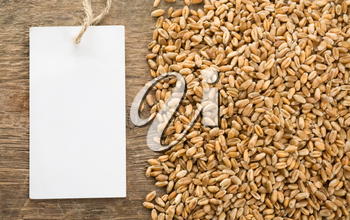 wheat grain on wood texture background