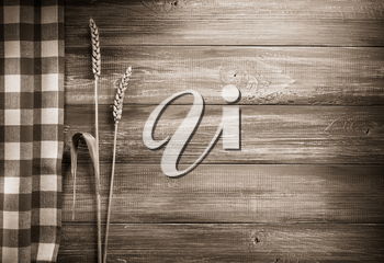 ears of wheat  on wooden background