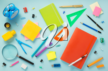 notebook and school accessories at abstract background surface