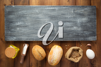 bakery ingredients on wooden background table, top view