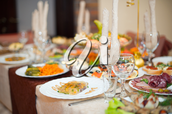 Beautifully decorated table with dishes.