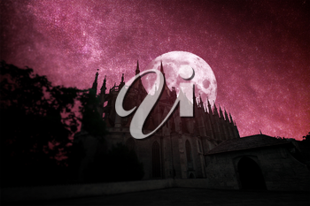 Kutna Hora in the Czech Republic. at night the stars and the moon shine.