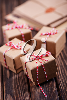 box for present and hearts on the wooden table